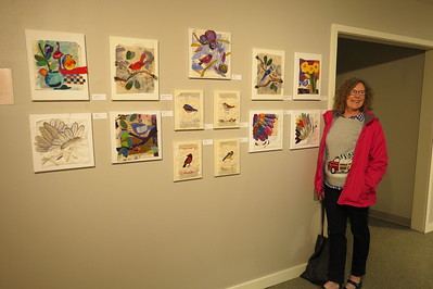 Jeanelle in front of her bird stitcheries