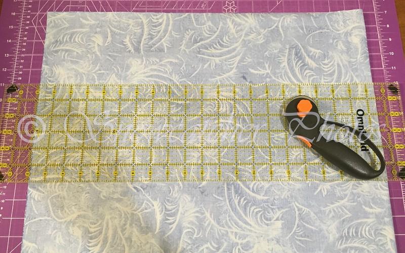 preparing to cut my own charm squares
