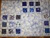 sashed alternating darker blocks, even larger blocks of focus fabric