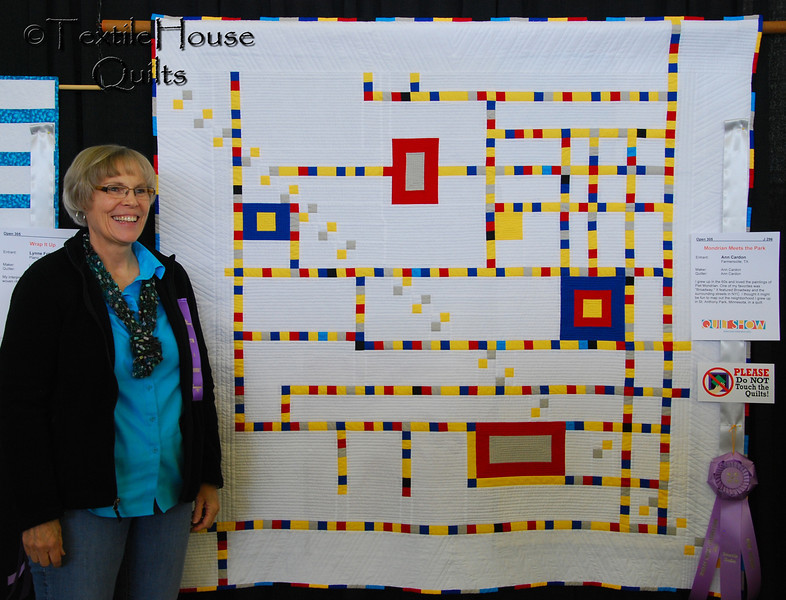 Ann Cardon with her quilt and ribbon