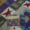 Closer look at the strips, blocks and book where this one was the cover quilt.