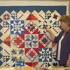 Sharyn discusses how she took small orphaned blocks and put them together to make this quilt.