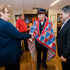 Darlene Coit and Mayor Stephen DiNatale present Fitchburg Firefighter and USMC veteran Anthony Liberatore with a Quilt of Valor during a small ceremony at the Golden Living Center on Friday afternoon. SENTINEL & ENTERPRISE / Ashley Green