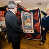 Darlene Coit  presents US Navy veteran and Mayor Stephen DiNatale with a quilt during the Quilts of Valor ceremony at the Golden Living Center on Friday afternoon. SENTINEL & ENTERPRISE / Ashley Green