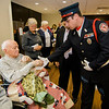 USMS veteran and Fitchburg Firefighter Anthony Liberatore shakes the hand of veteran Joseph Kutka after he is presented with a Quilt of Valor during a small ceremony at the Golden Living Center on Friday afternoon. SENTINEL & ENTERPRISE / Ashley Green