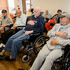 Veterans put their hands over their hearts during the Pledge of Allegience during the Quilts of Valor ceremony at the Golden Living Center on Friday afternoon. SENTINEL & ENTERPRISE / Ashley Green