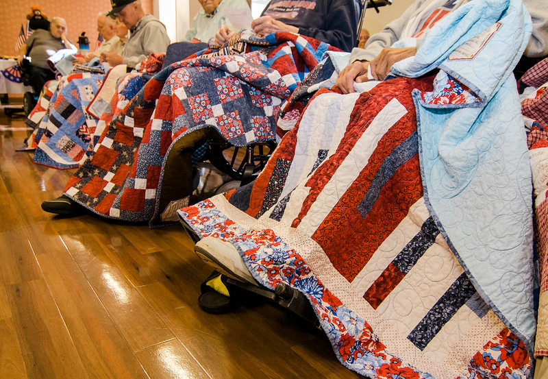 Veterans receive Quilts of Valor during a small ceremony at the Golden Living Center on Friday afternoon. SENTINEL & ENTERPRISE / Ashley Green