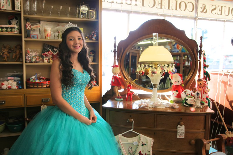 A Quinceanera's favorite place in town, an antique store