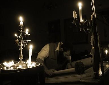 R' Micha examining Torah Scroll