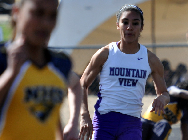 Mountain View's Yasmine Hernandez rounds the corner of the 400-meter run Thursday April 13, 2017 during the R2J Invite in Loveland. (Cris Tiller / Loveland Reporter-Herald)