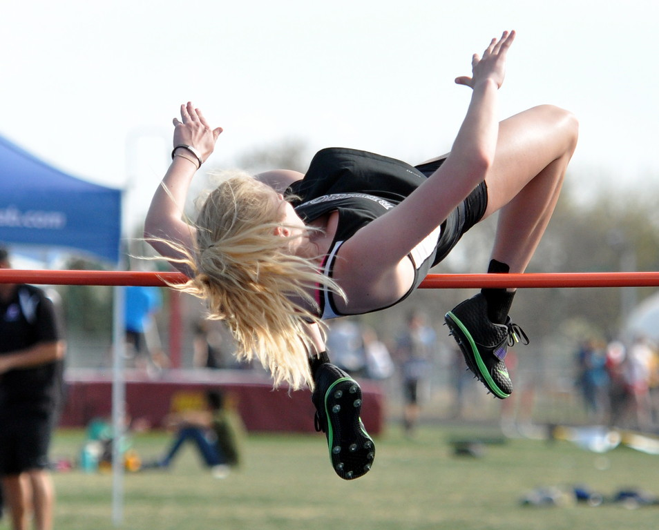 Berthoud's Cailey Archer clears the high jump bar Thursday April 13, 2017 during the R2J Invite in Loveland. (Cris Tiller / Loveland Reporter-Herald)