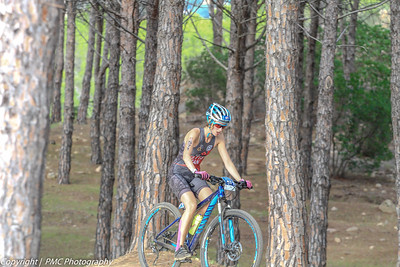 Clara on her last lap riding through the beautiful pines of the nature preserve.