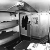 """Taken by a professional photographer Spring 1974<br /> <br /> The poster on the top bunk was for Ronan film """"Gold:""""<br /> <br /> Known as the Hippy Hilton.... This cabin was upgraded by Norman and Micky with Micky in the top bunk<br /> <br /> Note the centre light was stained glass coloured with lead by Micky at his house in Delft. Norman put two bulbs in and engineered them to be dimmer.... The atmosphere was enhanced by carpets on the wall behind the camera, carpet tiles on the table all designed to create a softer atmosphere :-)<br /> <br /> This contrasted with the harsh fluorescent lighting in the mess room upstairs :-)<br /> <br /> We used to gather in there and Captain Meyer used to put his head around the door and peer into the haze saying """"Shtuffie Rokers"""" :-)<br /> <br /> When Micky was not on board the top bunk was mine...... It still had a 'DLT' letraset label left over from the 60's with a Bunny Club label next to it"""