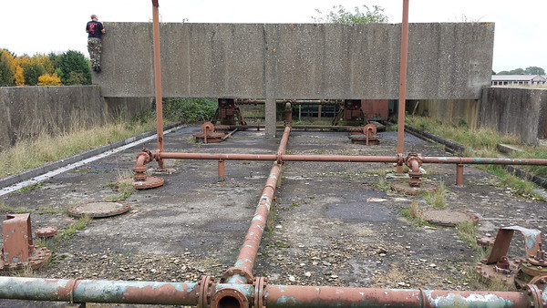 I understand there were large tanks under here..the flanges have been filled with concrete