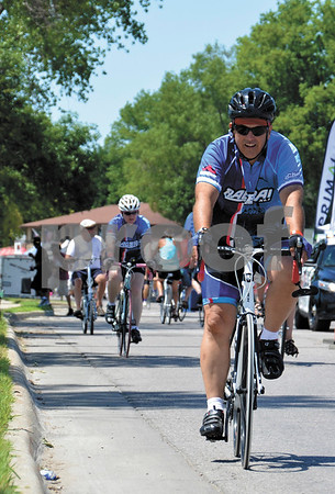-Messenger photo by Britt Kudla<br /> Brad Foldenawer joins fellow RAGBRAI riders in Storm Lake on Sunday