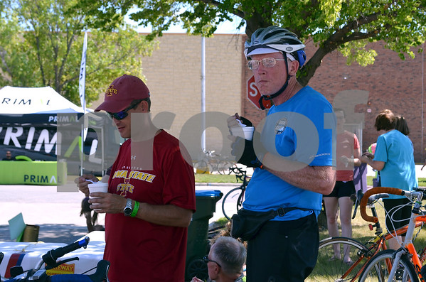 - Messenger photo by Peter Kaspari<br /> <br /> Scott Herren, left, of West Des Moines, and Jon Buss, of Ames, enjoy some homemade ice cream just outside of Crossroads Mall Monday as RAGBRAI riders spent the day in town. Buss was riding in the race, and Herren was driving the support vehicle.