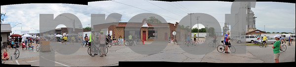-Messenger photo illustration by Joe Sutter<br /> <br /> This image, made from multiple photos, shows the south end of the RAGBRAI vendor area in Manson Monday morning, with the water refilling station at center. Center left, Chris and Brenda Frazier, of DeWitt, stop for water during their first time on a RAGBRAI ride.