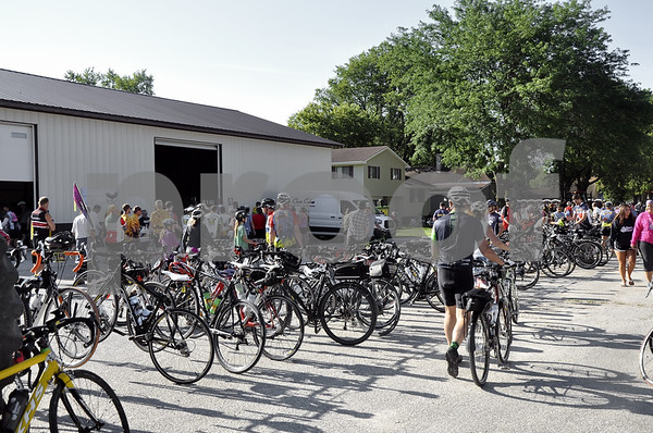 - Messenger photo by Peter Kaspari<br /> <br /> A row of bikes line the street in downtown Duncombe Tuesday as RAGBRAI riders stopped in town on the cross-state bike ride. Local businesses and service organizations offered food and drinks to the travelers.