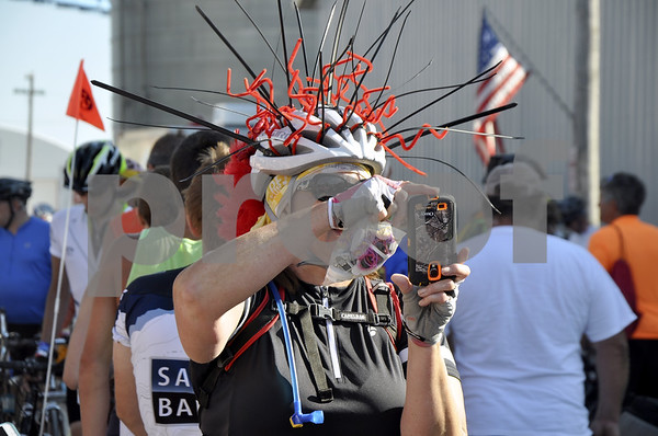 - Messenger photo by Peter Kaspari<br /> <br /> Mary Caligiuri, of Des Moines, takes a photo during RAGBRAI's stop in Duncombe Tuesday.
