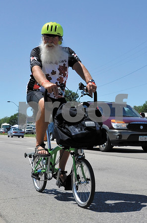 -Messenger photo by Britt Kudla<br /> Larry Vaney of Coldspring, Kentucky take part in RAGBRAI on Sunday in Storm Lake