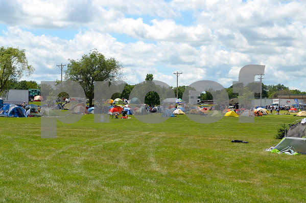 - Messenger photo by Peter Kaspari<br /> <br /> RAGBRAI riders set up their tents on the field at Fort Dodge Senior High School Monday as they prepared to spend the night in town.