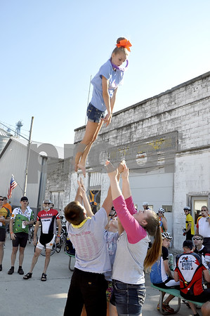 - Messenger photo by Peter Kaspari<br /> <br /> Ayrton Peterson, 14, gets flipped in the air by, from left, Alex Craig, 16, Courtney Shirbroun, 18, and Kearstyn Lennon, 16, all of Fort Dodge. The United All Star members were performing for RAGBRAI riders in Duncombe Tuesday.