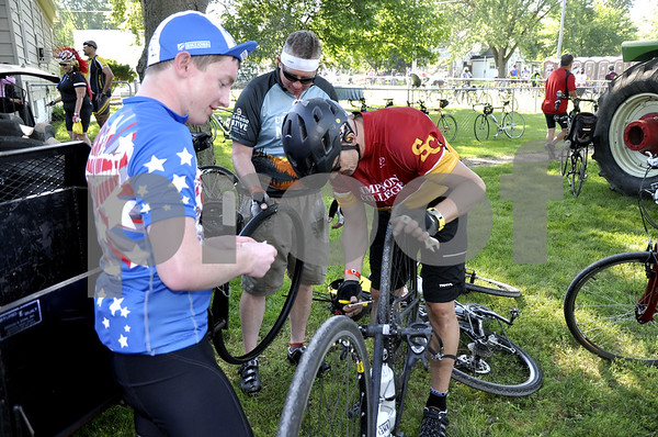 - Messenger photo by Peter Kaspari<br /> <br /> Members of the Simpson College RAGBRAI team, from left, Miles Kirts, Kelly Kirts and Bryan Gregston, repair one of their bikes in Duncombe Tuesday. Duncombe was one of the stopping points on the cross-state bike ride.