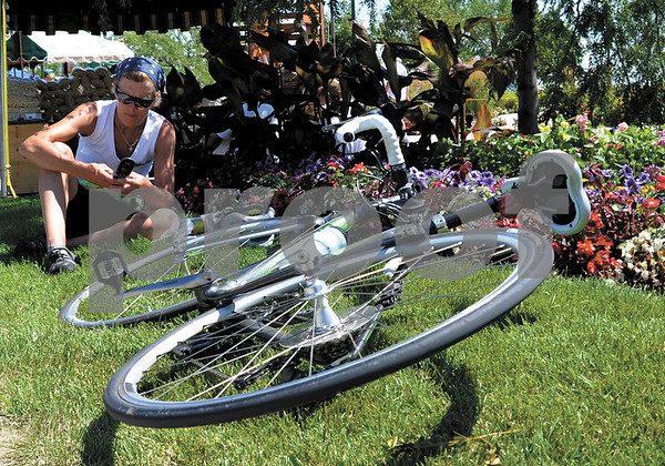 -Messenger photo Britt Kudla<br /> Tammy Larson of Sioux City rests for a while after riding from Hanover to Storm Lake during RAGBRAI on Sunday