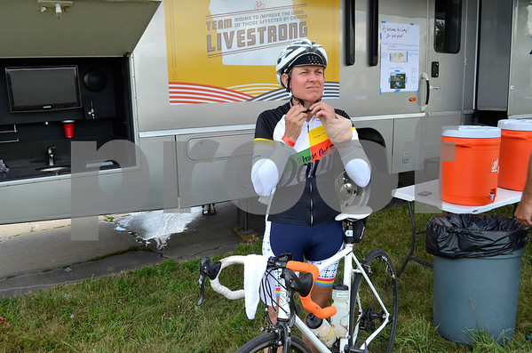- Messenger photo by Peter Kaspari<br /> <br /> Kim Barnett, of Austin, Texas, straps on her helmet during RAGBRAI's overnight stop in Fort Dodge Monday. Barnett, who injured her wrist after driving over a hose during the race, said she was still planning on finishing despite her injury.