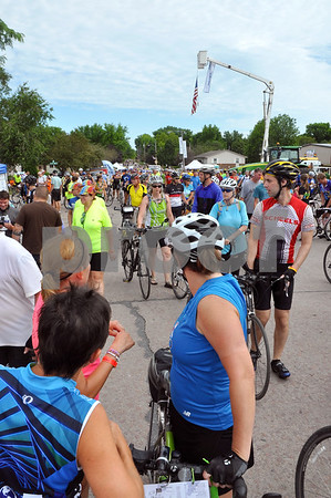 -Messenger photo by Joe Sutter<br /> <br /> RAGBRAI riders crowd Main Street in Manson on Monday. The riders came in from the north and enjoyed vendor booths and a beer garden in Manson's downtown.