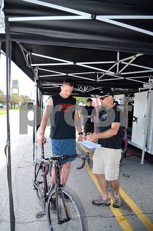 - Messenger photo by Peter Kaspari<br /> <br /> Thomas Geiser, left, of Galbton, Pennsylvania, looks over a bike as Jeremy McKinley, of Trek Bicycles, talks to him about the bike's features. The business provides bikes that can be tested out by riders.