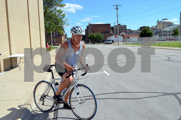 - Messenger photo by Peter Kaspari<br /> <br /> Keith Bryhne, of Fort Dodge, prepares to ride off from St. Olaf Lutheran Church Monday after taking a lunch break during RAGBRAI. Bryhne, who also rides motorcycles, said it's more challenging riding long distances on a bicycle.
