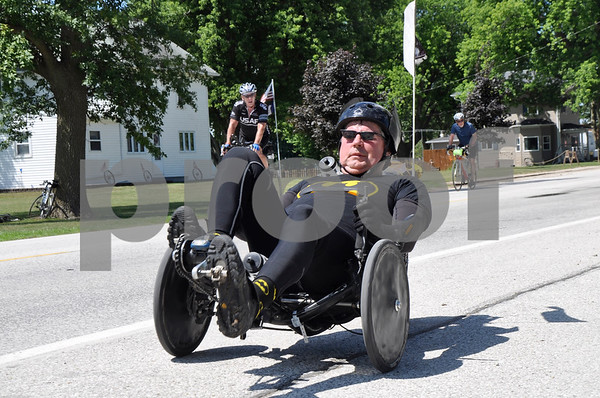 -Messenger photo by Joe Sutter<br /> <br /> Brad Bosworth, of Nevada, rolling through the Clare stop on RAGBRAI Monday afternoon, said a friend told him his all black recumbant trike looked like the Batmobile, so he decided to dress the part.