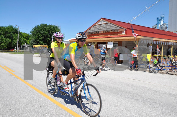 -Messenger photo by Joe Sutter<br /> <br /> Husband and wife Melissa Lanzourakis and Al Joens, of Sioux City, said the tandem bike is nice because they can help each other out when tired, while coming through Clare on RAGBRAI Monday.
