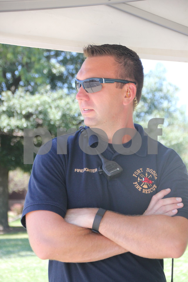 Jason Reynolds is one of many people who volunteered to help out with RAGBRAI when the thousands of riders rode into Fort Dodge on Monday, July 20, 2015. He is with the Fire and Rescue.