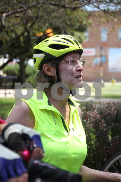 One of the thousands of RAGBRAI  riders was Pam Conkling, seen here resting  and cooling off  after she other many other riders had rolled into Fort Dodge for their overnight stay on Monday, July 20, 2015.