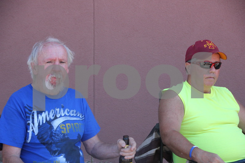 Robbie McDonald (left) and Don Willie (right) were volunteering to help out with the RAGBRAI event on Monday, July 20, 2015 when the thousands of riders  rolloed into Fort Dodge for their  overnight stay in town. They provided little smokies for them.