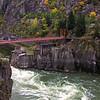 Red bridge over the Thomson River, Canada