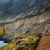 Majestic view of the Rocky Mountaineer as it passes imposing cliffs