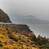 Rocky Mountaineer rounds the bend with views on a lake bursting with fall foliage