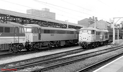 """31105 & 86239 """"L S Lowry"""" are seen at Crewe on 16th September 1991."""