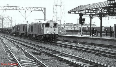 A ballast train enters Crewe from the south, double-headed by 20058 (leading) and 20087; Crewe diesel depot yard abounds with 31's & 47's. 9th October 1988.
