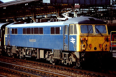 """87101 """"Stephenson"""" is seen at the head of a southbound passenger service at Crewe. 1988."""