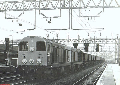 A pair of blue-liveried class 20's, headed by 20019, heads north through Crewe with an MGR train.