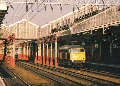 An unidentified Class 85 locomotive stands at the head of a relatively short passenger train for the south at Crewe. Late 1987.