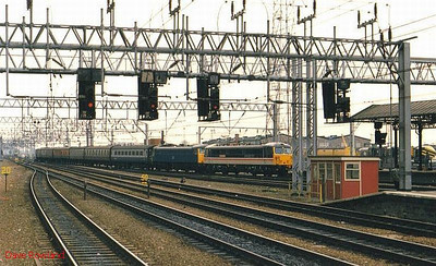Unidentified Class 87 & 85 locos double-head what is probably a Holyhead train into Crewe station. Possibly 1987.