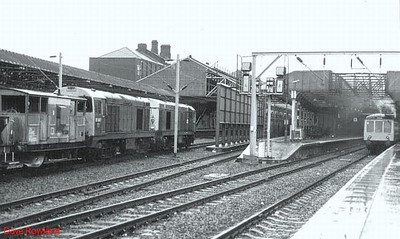 20087 is the closest of these two Class 20 'Choppers' as they move north through Crewe station with a ballast train. The leading loco is 20058. 9th October 1988.