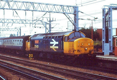 """Large logo 37431 """"Sir Powys/County of Powys"""" arrives at Crewe with a passenger working on 10th JUne 1988."""