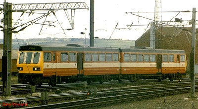141 119 is pictured in red & white livery at Leeds station. Unfortunately, the switch from light green to the West Yorkshire Metro colour scheme never improved the ride in these units!.