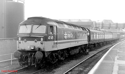 InterCity liveried 47471 is seen shunting a rake of vans at Bradford Interchange on 1st September 1991.